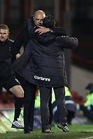 Football - League One - Brentford vs. Oldham Athletic<br /> Brentford manager, Uwe Rosler and Oldham manager, Paul Dickov, hug after the match.