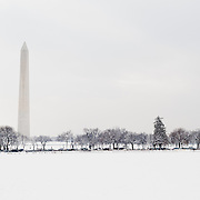 The National Mall, with the distinctive Washington Monument at left, blanketed by snow after a recent heavy snowfall.
