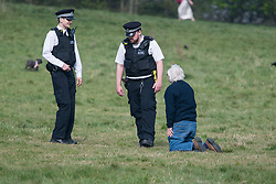 © Licensed to London News Pictures. 08/04/2020. London, UK. Police move a member of the public lying down on Hampstead Heath, North London, during a pandemic outbreak of the Coronavirus COVID-19 disease. The public have been told they can only leave their homes when absolutely essential, in an attempt to fight the spread of coronavirus COVID-19 disease. Photo credit: Ben Cawthra/LNP