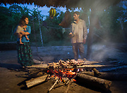 The meat of the Coatis, a hunted animal from the amazon jungle, is smoked over a fire.