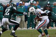 PHILADELPHIA - NOVEMBER 18: The Philadelphia Eagles bring down a run during the game against the Miami Dolphins on November 18, 2007 at Lincoln Financial Field in Philadelphia, Pennsylvania.