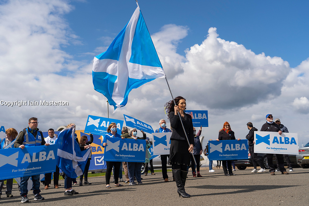 Falkirk, Scotland, UK. 30 April 2021. Leader of the pro Scottish nationalist Alba Party , Alex Salmond, campaigns with party supporters at the Falkirk Wheel ahead of Scottish elections on May 6th. Pic; Tasmina Ahmed-Sheikh holds Scottish flag.  Iain Masterton/Alamy Live News