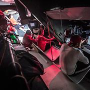 Leg 02, Lisbon to Cape Town, day 10, on board MAPFRE. Vida a bordo, Al fonto Tamara Echegoyen, en la mesa de navegaci'on Xsbi Fernandez y Joan vila. Pablo Arrarte observando desde su litera y Antonio Cuervas-Mons escribiendo un mail a la familia en el ouesto de trabajo del reportero de a bordo. Photo by Ugo Fonolla/Volvo Ocean Race. 14 November, 2017