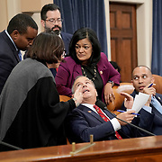 Rep. David Cicilline (D-R.I.) speaks to a staffer, Reps. Joe Neguse (D-Colo.), Pramila Jayapal and /.during a House Judiciary Committee markup of H.Res. 755, Articles of Impeachment Against President Donald J. Trump, on Thursday, December 12, 2019.
