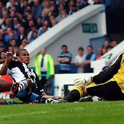 Newcastle United's Kireon Dyer sees his shot saved by  Manchester City goalkeeper Peter Schmeichel as Sylvain Distin slides in