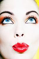 beautiful caucasian woman portrait sending kiss studio on yellow background