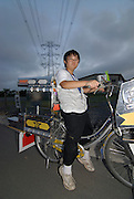 """Shota Hashimoto (13) with his decochari customized bicycle. """"My bike weighs 30 to 40 kilos, so its a bit hard to drive on the road."""""""