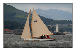 Richard Matthews in , Pierrette 1899, a 28' day boat sailing in Class two on the third days racing off Gantocks Rocks...This the largest gathering of classic yachts designed by William Fife returned to their birth place on the Clyde to participate in the 2nd Fife Regatta. 22 Yachts from around the world participated in the event which honoured the skills of Yacht Designer Wm Fife, and his yard in Fairlie, Scotland...FAO Picture Desk..Marc Turner / PFM Pictures