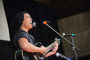 """San Jose State University creative arts student Denny Pham (Class of 2014) performs an original song, """"Only You, Lovely You"""" during Humanities & Arts Day Student Showcase at San Jose State University's Student Union Barrett Ballroom in San Jose, California, on October 25, 2013. (Stan Olszewski/SOSKIphoto)"""