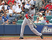 ATLANTA - JUNE 28:  First baseman David Ortiz #34 of the Boston Red Sox swings and makes contact during the game against the Atlanta Braves at Turner Field on June 28, 2009 in Atlanta, Georgia.  The Braves beat the Red Sox 2-1.  (Photo by Mike Zarrilli/Getty Images)