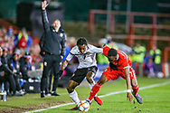 Trinidad and Tobago midfielder Cordell Cato holds off Wales midfielder Rabbi Matondo during the Friendly European Championship warm up match between Wales and Trinidad and Tobago at the Racecourse Ground, Wrexham, United Kingdom on 20 March 2019.