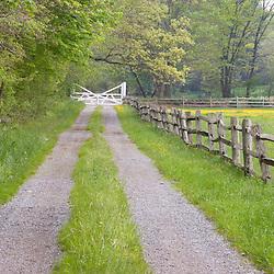 A split rail fence and farm road in Ipswich Massachusetts USA