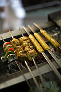 A cook prepares fresh kebabs at Karim's Restaurant, Delhi, India