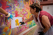 08/09/2015 - Lisbon, Portugal: Lurdes Silva, 80, painting a stecil with her hand  during the Lata 65 workshop. Lata 65 was project created by Lara Seixo Rodrigues and is a creative workshop teaching street art to senior citizens. (Eduardo Leal)