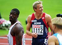 Friidrett, 6.august 2002. Europamesterskapet 2002 München.Geir Moen, Norge, og Dwain Chambers, England, etter 100 meter.