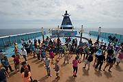 A dancing party is seen on the deck of the Grimaldi Lines Cruise Barcelona during the Civitavecchia-Barcelona trip, in Italy, on Sunday, June 9, 2013.  Photographer: Víctor Sokolowicz/Bloomberg.