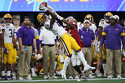 Terrace Marshall Jr. #6 of the LSU Tigers catches a pass against Tre Brown #6 of the Oklahoma Sooners during the first half of the 2019 College Football Playoff Semifinal at the Chick-fil-A Peach Bowl on Saturday, Dec. 28, in Atlanta. (Jason Parkhurst via Abell Images for the Chick-fil-A Peach Bowl)