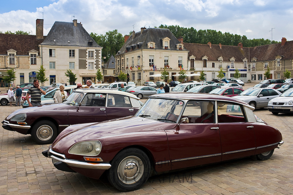 Traditional Citroen DS saloon cars in Place du Marche town square, Richelieu, France