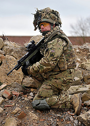 © Licensed to London News Pictures. 09/03/2012. Copedown Hill, UK. A soldier on a patrol exercise. Secretary of Defence Philip Hammond visits troops during the day. The 12thMechanized Brigade (12 Mech Bde) at Copehill Down, Salisbury Plain Training Area, Wiltshire,on FRIDAY 09 MARCH 2012, as it prepares to deploy to Helmand Province, Afghanistan, on Operation Herrick 16, in the Spring of this year. The Brigade were performing a dynamic demonstration of combined Afghan/ISAF operations supported by surveillance assets and casualty evacuation capability. Tornado GR4 fast jest ground support was also displayed.. Photo credit : Stephen SImpson/LNP