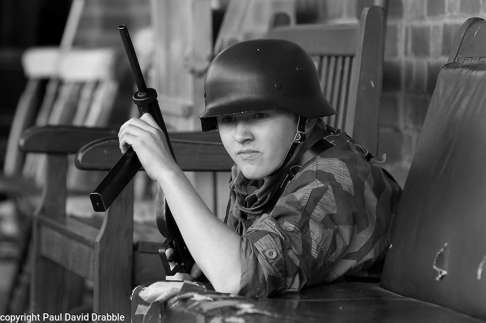 Re-enactor dressed as a Volkssturm (a member of the National Militia) during a living history display at Elsecar Heritage centre 1940s Wartime weekend .4 September 2010 .Images © Paul David Drabble..