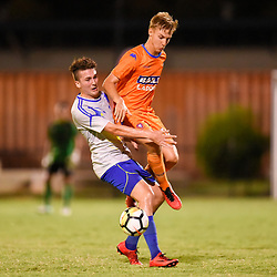 BRISBANE, AUSTRALIA - JANUARY 27: Sebastian Scaroni of the Strikers and Jesse Daley of Lions collide during the Kappa Silver Boot Grand Final match between Lions FC and Brisbane Strikers on January 27, 2018 in Brisbane, Australia. (Photo by Patrick Kearney)