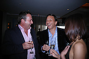 Hwyell James, Rocco Forte and Lucy Owen. Krug at Tides Bar and Grill. St. David's `Hotel and Spa. Carfiff Bay. 14 April 2005. ONE TIME USE ONLY - DO NOT ARCHIVE  © Copyright Photograph by Dafydd Jones 66 Stockwell Park Rd. London SW9 0DA Tel 020 7733 0108 www.dafjones.com