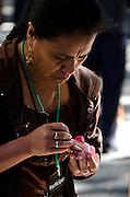 Woman carving radish figure for Noche de Rabanos, Oaxaca, Mexico.