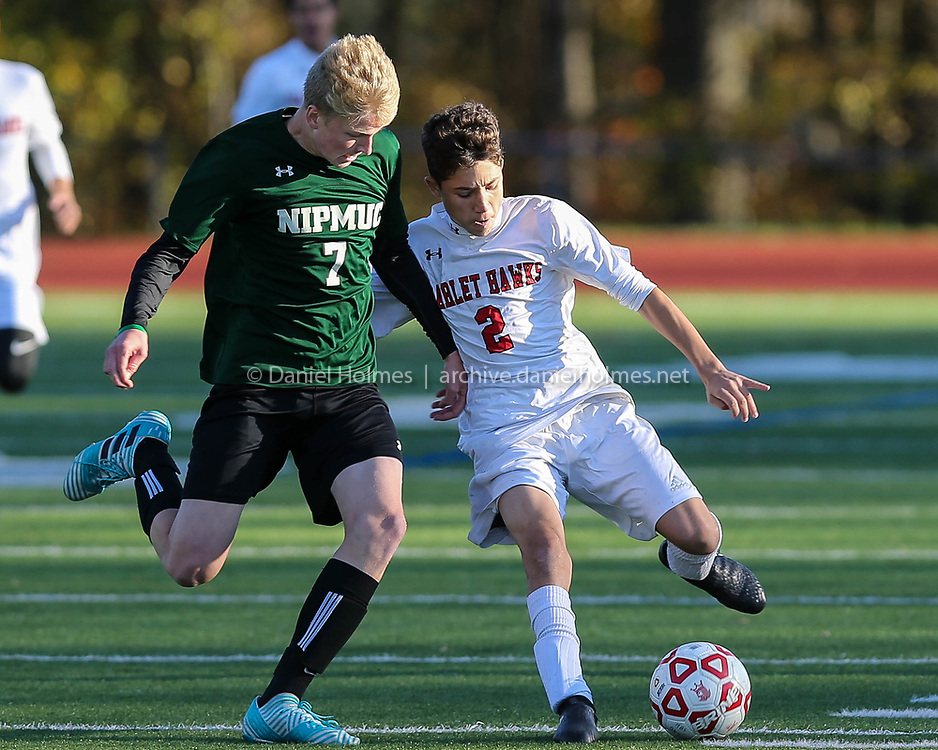 (10/31/17, MILFORD, MA) Milford's Leo Coelho, right, and Nipmuc's Jake Grant fight for the ball during the boys soccer game against Nipmuc at Milford High School on Tuesday. [Daily News and Wicked Local Photo/Dan Holmes]