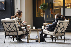 © Licensed to London News Pictures. 15/12/2020. London, UK. People enjoy a coffee outdoors near Regent Street in London's West End. London and other areas of the south east are to enter tier three restrictions at midnight tonight as Covid-19 infection rates rise. Photo credit: Peter Macdiarmid/LNP