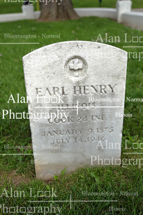 26 August 2017:   A part of the History of McLean County Illinois.<br /> <br /> Tombstones in Evergreen Memorial Cemetery.  Civic leaders, soldiers, and other prominent people are featured. Section 5, the old town soldiers area<br /> Earl Henry  Illinois Cook 24 INF  January 9, 1875  July 14, 1946