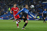 Bret Pitman of Bournemouth shoots at goal, watched by Declan John of Cardiff. Capital One Cup, 3rd round match, Cardiff City v AFC Bournemouth at the Cardiff City stadium in Cardiff, South Wales on Tuesday 23rd Sept 2014<br /> pic by Mark Hawkins, Andrew Orchard sports photography.