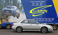 """Subaru Impreza WRX WRP10 - a limited edition model exclusive to the Australian market. In front of Subaru Australia Rally Team Truck.The WRP10 was available from late January 2005 and was limited to 200 units, featuring individually numbered badges..The model name comes from Subaru's heritage, the """"WR"""" represents Impreza WRX's success in World Rally competition, """"P"""" the enormous rallying contribution from Pirelli tyres and """"10"""" the years since launch of the original Impreza WRX""""..Available exclusively in Crystal Grey Metallic manual sedan, the WRP10 includes a STI engine performance upgrade kit increasing peak power from standard WRX's 168 kW @ 6,000 rpm to175kW @ 6,000 rpm..The kit includes a replacement Electronic Control Unit, upgraded exhaust components and a unique large single tip muffler..A carbon fibre strut brace and WRX suspension lowering kit, with stiffer springs drop the car's ride height by 15mm..WRP10 is finished off with high performance, lightweight five-spoke forged alloy RAYS wheels and Pirelli P Zero Nero tyres (215 45Z R 17 91Y)..The limited edition model was the first developed by STI Australia, in conjunction with STI Japan .(C) Joel Strickland Photographics.Use information: This image is intended for Editorial use only (e.g. news or commentary, print or electronic). Any commercial or promotional use requires additional clearance."""