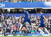 Football - 2018 / 2019 Premier League - Chelsea vs. Liverpool<br /> <br /> Antonio Rudiger (Chelsea FC) powers a header back to his keeper as Liverpool press forward at Stamford Bridge <br /> <br /> COLORSPORT/DANIEL BEARHAM