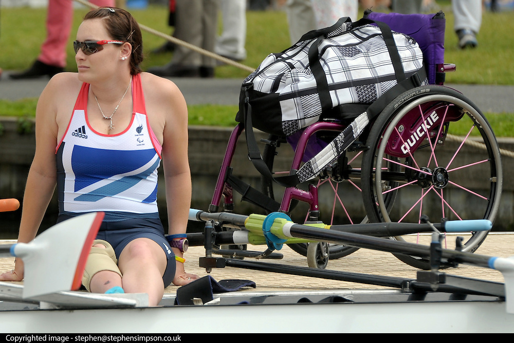 © Licensed to London News Pictures. 27/06/2012. Henley-on-Thames, UK Sam Scowen rests on the quay side before getting into her scull. Great Britain's rowing team for the London 2012 Paralympics was announced during Wednesday's lunch interval and the four crews rowed down the Henley course through the enclosures. Henley Royal Regatta on June 26, 2012 in Henley-on-Thames, England. The 172-year-old rowing regatta is held 27th June- 1st July 2012. Photo credit : Stephen Simpson/LNP