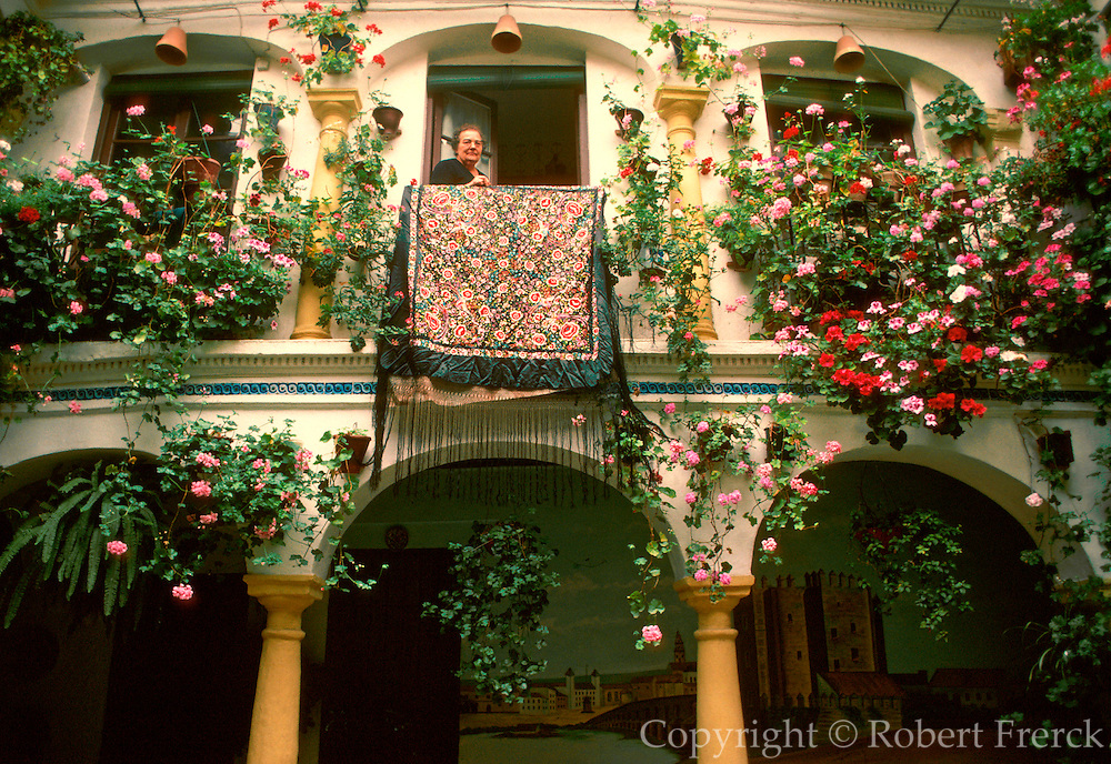 SPAIN, ANDALUSIA, CORDOBA one of the medieval Moorish courtyards with whitewashed walls hung with flower pots that Cordoba is famous for