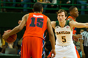 WACO, TX - JANUARY 3: Brady Heslip #5 of the Baylor Bears defends Keierre Richards #15 of the Savannah State Tigers on January 3, 2014 at the Ferrell Center in Waco, Texas.  (Photo by Cooper Neill) *** Local Caption *** Brady Heslip