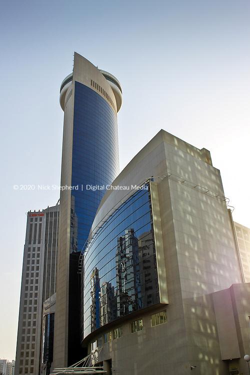 Abu Dhabi Skyline reflected in the glass.