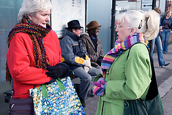 Group of older people waiting at a bus stop