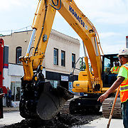 Cutting into Main Street in downtown Kansas City for the KC Streetcar groundbreaking ceremony, May 22, 2014.