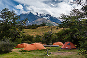 Glacier-clad Monte Almirante Nieto rises above Fantástico Sur's Camping Central in Torres del Paine National Park, Ultima Esperanza Province, Chile, Patagonia, South America. The Park is honored as a World Biosphere Reserve by UNESCO.