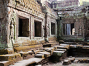 Bas relief carvings in the walls of a temple at Angkor, Siem Reap Province, Cambodia