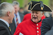 Old comrades enjoy a joke - The Combined Cavalry OCA Parade, Hyde Park. More than two thousand cavalrymen march in a mixture of uniforms or suits with bowler hats (for officers only) and furled umbrellas creating a quintessentially British scene. It is the 93rd Annual Parade and Service of The Combined Cavalry Old Comrades Association at the Cavalry Memorial adjacent and the Bandstand in Hyde Park. Field Marshal Baron Guthrie GCB, LVO, OBE, DL Colonel The Life Guards and Gold Stick took the salute at the march past for both serving and former soldiers of all the Regiments of Regular Cavalry and many Yeomanry Regiments.
