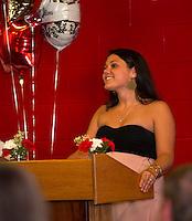 Megan Long honored Ms. Jannine Farrar, Business Tech Teacher during Laconia High School's Top Ten senior dinner held at the Huot Center Tuesday evening.  (Karen Bobotas/for the Laconia Daily Sun)