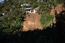 Landslide in San Luis Planes, Santa Bárbara. The region of Santa Bárbara continues to be badly affected by landslides. Fairtrade-certified cooperative Montaña Verde is based in San Luis Planes and coop members are all affected by climate change, hurricanes and landslides. Serious problems with access to farms, loss of land, loss of topsoil, washed-out nutrients, the early fall of unripe cherries, leaf drop, root rot, and a proliferation of fungal diseases all affect the producers.