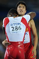ATHLETICS - IAAF WORLD CHAMPIONSHIPS 2011 - DAEGU (KOR) - DAY 3 - 29/08/2011 - 110M HURDLES FINAL - XIANG LIU (CHN) / 2ND - DAYRON ROBLES (CUB) / WINNER - PHOTO : FRANCK FAUGERE / KMSP / DPPI
