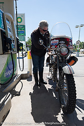 Terry Richardson of Kansas fuels his 1916 Harley-Davidson twin-cylinder 3-speed during the Motorcycle Cannonball Race of the Century. Stage-4 from Chillicothe, OH to Bloomington, IN. USA. Tuesday September 13, 2016. Photography ©2016 Michael Lichter.
