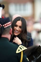Meghan Markle meets Pony Major Mark Wilkinson during a walkabout on the esplanade at Edinburgh Castle, while on their visit to Scotland. while on a walkabout on the esplanade at Edinburgh Castle, as she and Prince Harry visited Scotland.