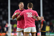 Wales players Rhys Priestland (l) and Dan Biggar warm up pre-match. . Rugby World Cup 2015 pool A match, England v Wales at Twickenham Stadium in London, England  on Saturday 26th September 2015.<br /> pic by  Andrew Orchard, Andrew Orchard sports photography.