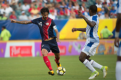 July 19, 2017 - Philadelphia, Pennsylvania, U.S - Costa Rica forward BRYAN RUIZ (10) takes a shot on goal defended by Panama midfielder Æ'DGAR BçRCENAS (8) during CONCACAF Gold Cup 2017 action at Lincoln Financial Field in Philadelphia, PA.  Costa Rica defeats Panama 1 to 0. (Credit Image: © Mark Smith via ZUMA Wire)