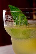 Legendre Herbsaint cocktail prepared with a mint leaf garnish.
